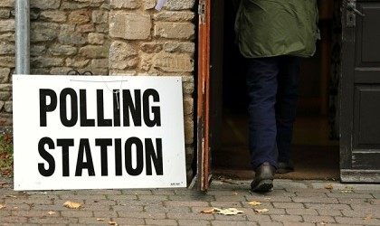 Person walking into polling station