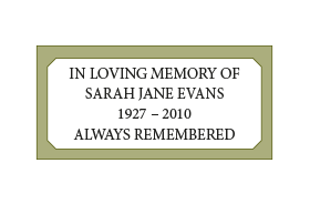 A cemetery plaque with four lines of wording