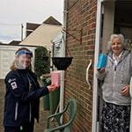 Ashington warden Christina Arnold delivers Brew Monday goodie bag