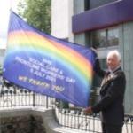 Chairman David Skipp raises an NHS flag in Horsham Carfax