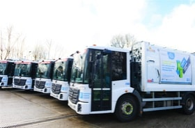 A fleet of waste and recycling trucks ready to go out on collection day