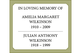 A cemetery plaque with seven lines of wording