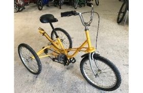 A yellow Tomcat trike with adjustable height saddle