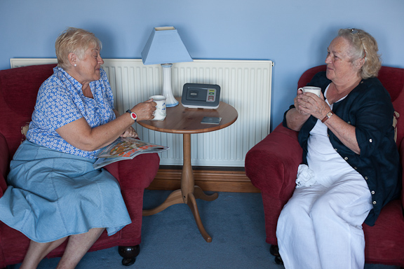 Residents pictured with their lifeline unit and pendant