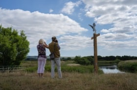 A couple look out over Pulborough Brooks grassland and meadows