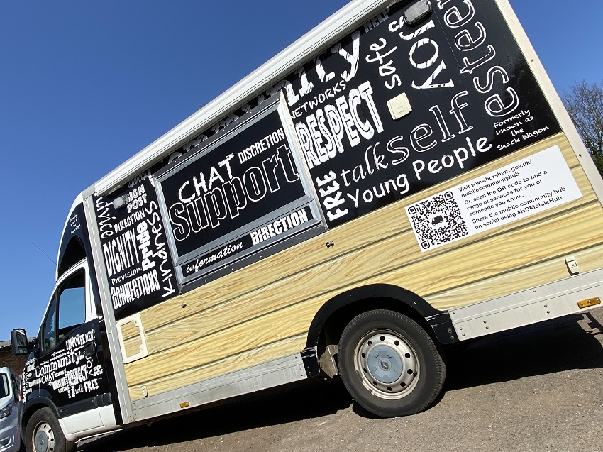 The Mobile Community Hub is decorated in black and white with inspiring words on it