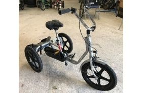 A silver trike with adjustable height saddle