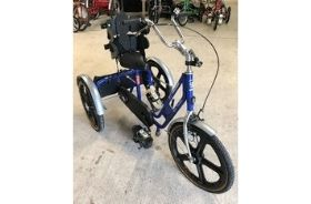 A blue trike with seat and harness