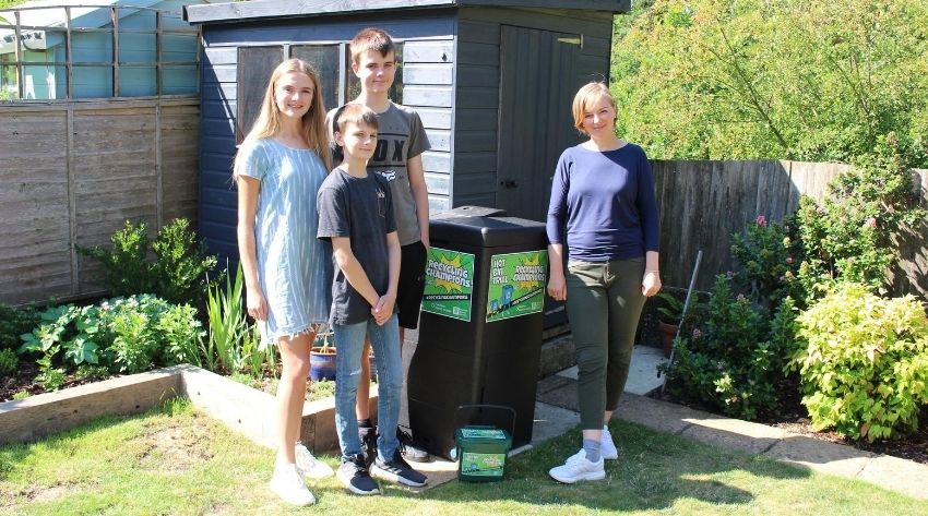 Recycling champion Amanda and family with their Hot Bin and caddy