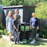 Amanda Coakley and her family with their new hot bin