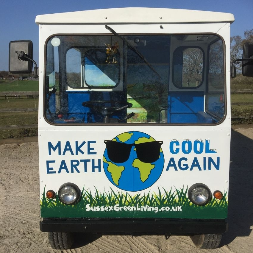 The front of the Eco station has the words Make Earth Cool Again on it and a globe wearing sunglasses