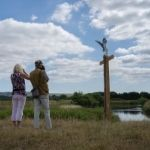 Two walkers look out over Pulborough Brooks on the Wildart Trail
