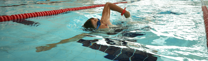 A boy swimming at Pavilions In The Park