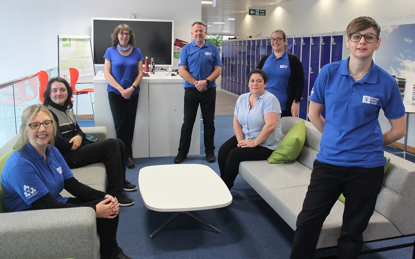 Our Community Link team have blue polo shirts with the Community Link logo
