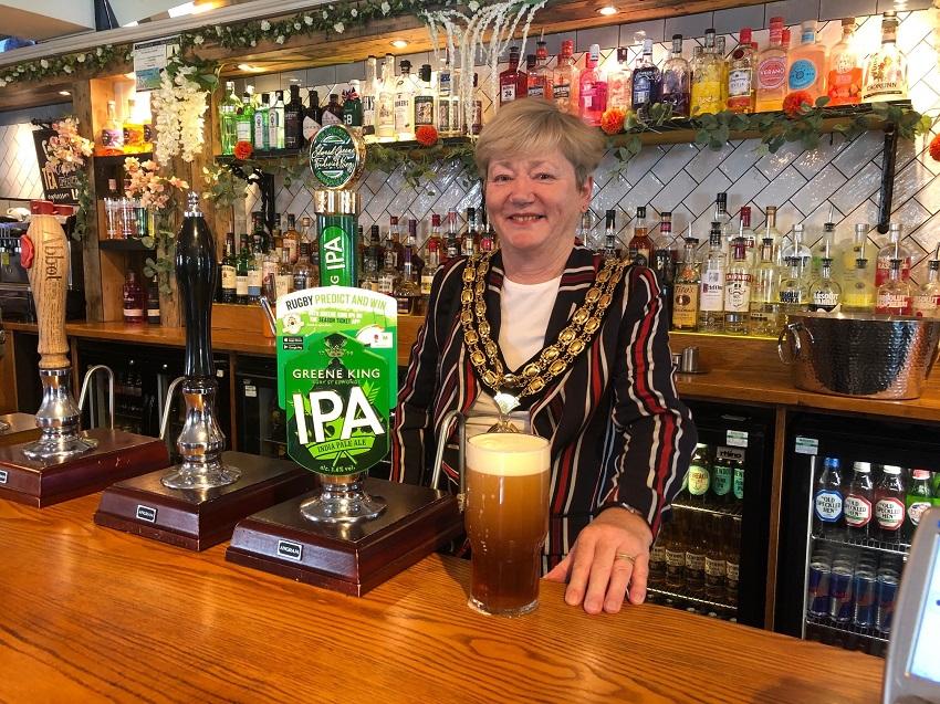 Chairman Cllr Karen Burgess pulls a pint at the Sussex Barn pub in north Horsham