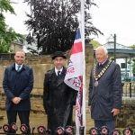 Cllr Billy Greening, RBLs Zal Rustom and HDC Chairman Cllr David Skipp raising the flag