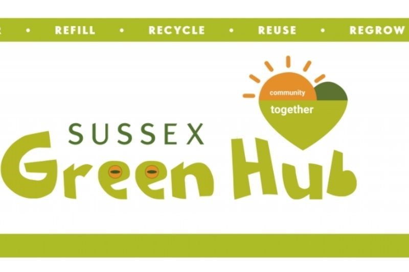 Sussex Green Hub. The logo is a green heart with a sunburst and the words Community Together