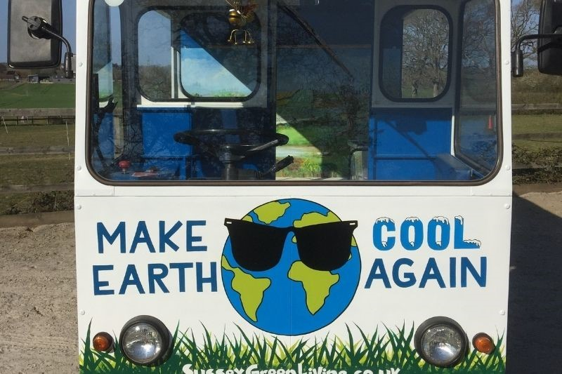 The Eco Station is an old fashioned milk float with Make Earth Cool Again on the front